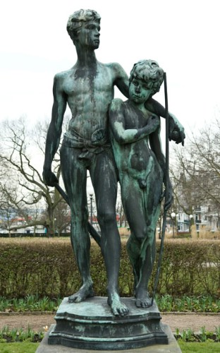 sculpture of a boy and a man